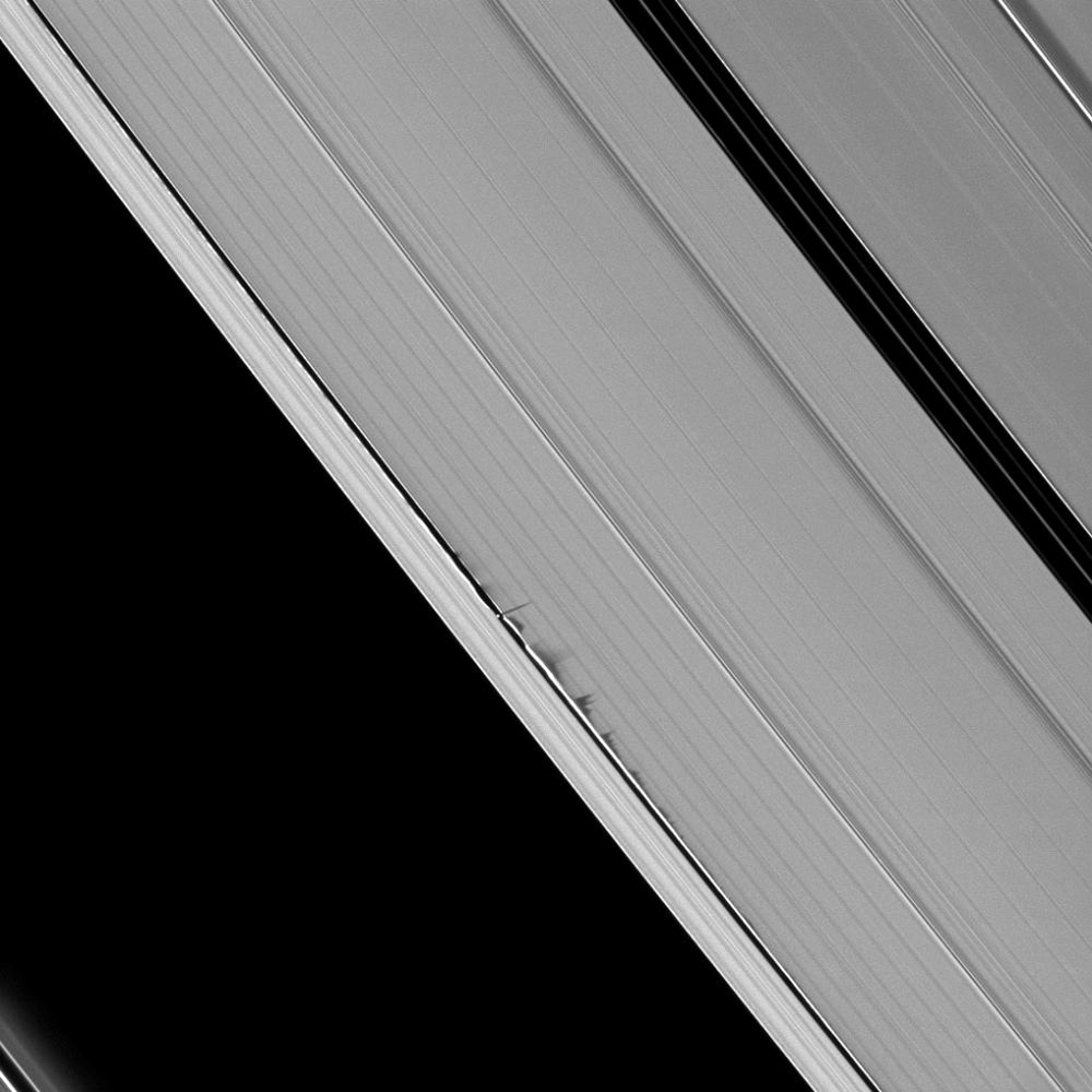 Jagged looking shadows stretch away from vertical structures of ring material created by the moon Daphnis in this image taken as Saturn approaches its August 2009 equinox. This image is from NASA's Cassini spacecraft.