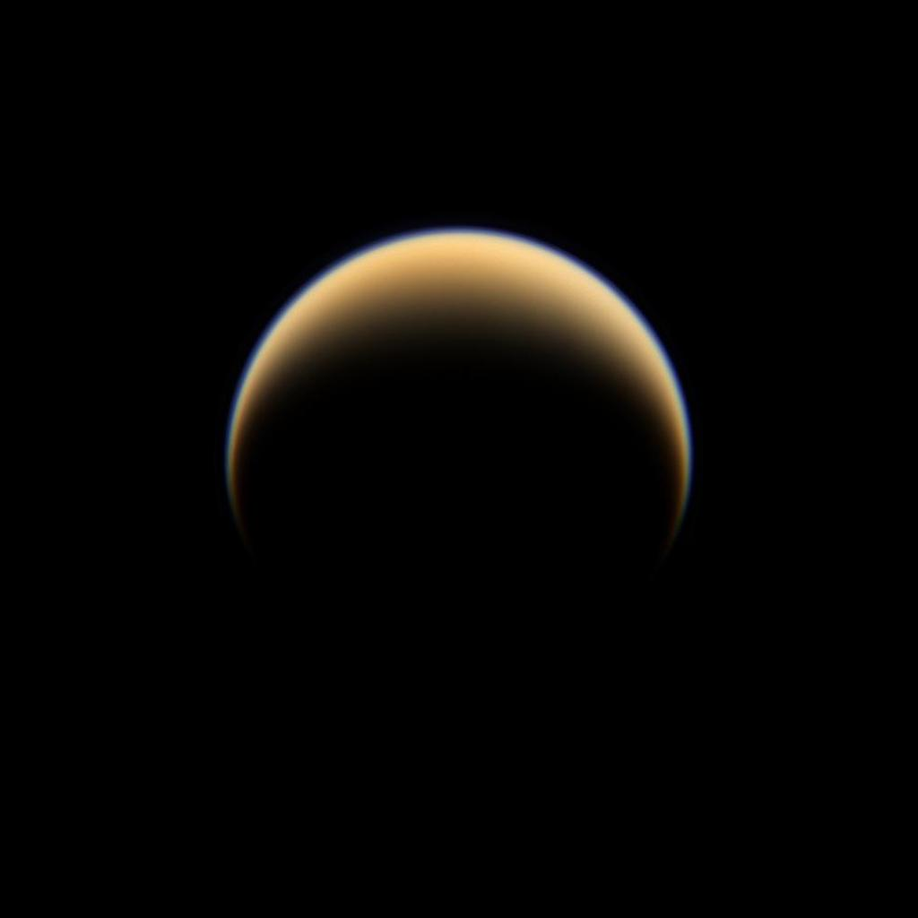 NASA's Cassini spacecraft looks down on the north pole of Titan, showing night and day in the northern hemisphere of Saturn's largest moon.
