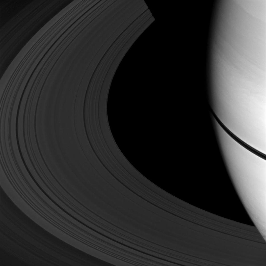 The shadows of Saturn's rings appear as a narrow band on the planet in this image taken as Saturn approaches its August 2009 equinox as seen by NASA's Cassini spacecraft.