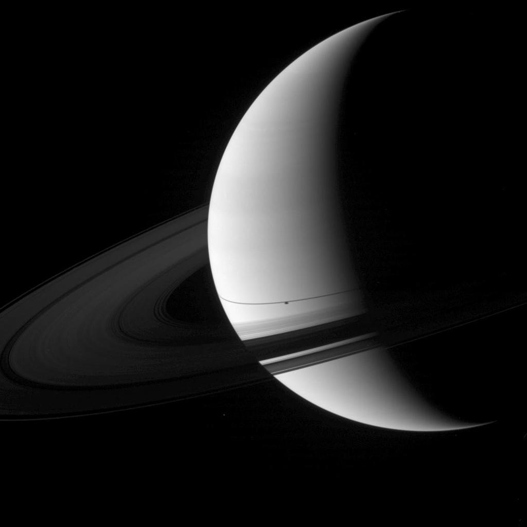 The shadow of the moon Enceladus appears on Saturn just south of the thin shadow of the planet's rings in this image captured by NASA's Cassini spacecraft.