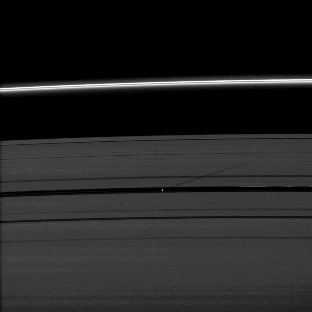 The moon Pan casts a shadow on Saturn's outer A ring in this image taken as the planet approached its August 2009 equinox. NASA's Cassini spacecraft took this image on July 29, 2009.