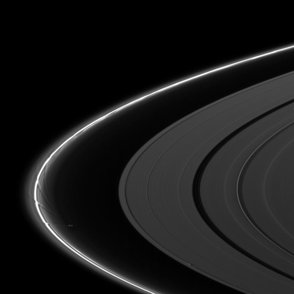 A scalloped look is created in the edges of the Keeler Gap in Saturn's outer A ring as the moon Daphnis orbits in the gap in this image from NASA's Cassini spacecraft taken on Feb. 25, 2009.