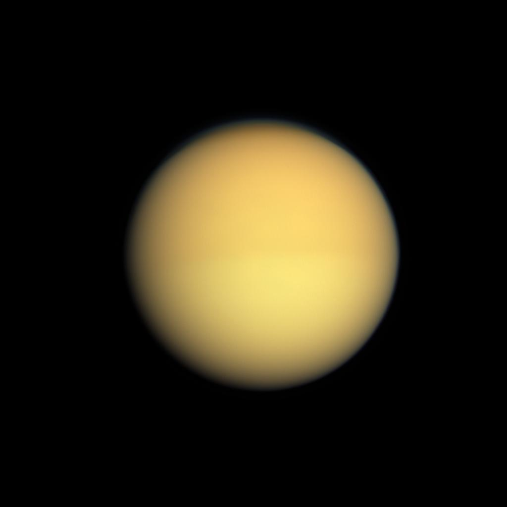 Seasonal changes in the atmosphere of Saturn's largest moon are captured by NASA's Cassini spacecraft, which shows Titan with a slightly darker top half and a slightly lighter bottom half.