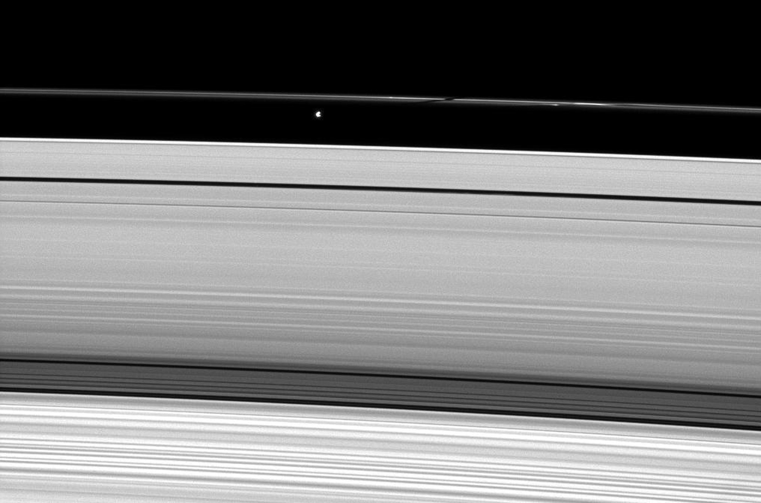 Saturn's moon Prometheus casts a shadow on the narrow F ring in this image captured by NASA's Cassini Orbiter weeks after the planet's August 2009 equinox.