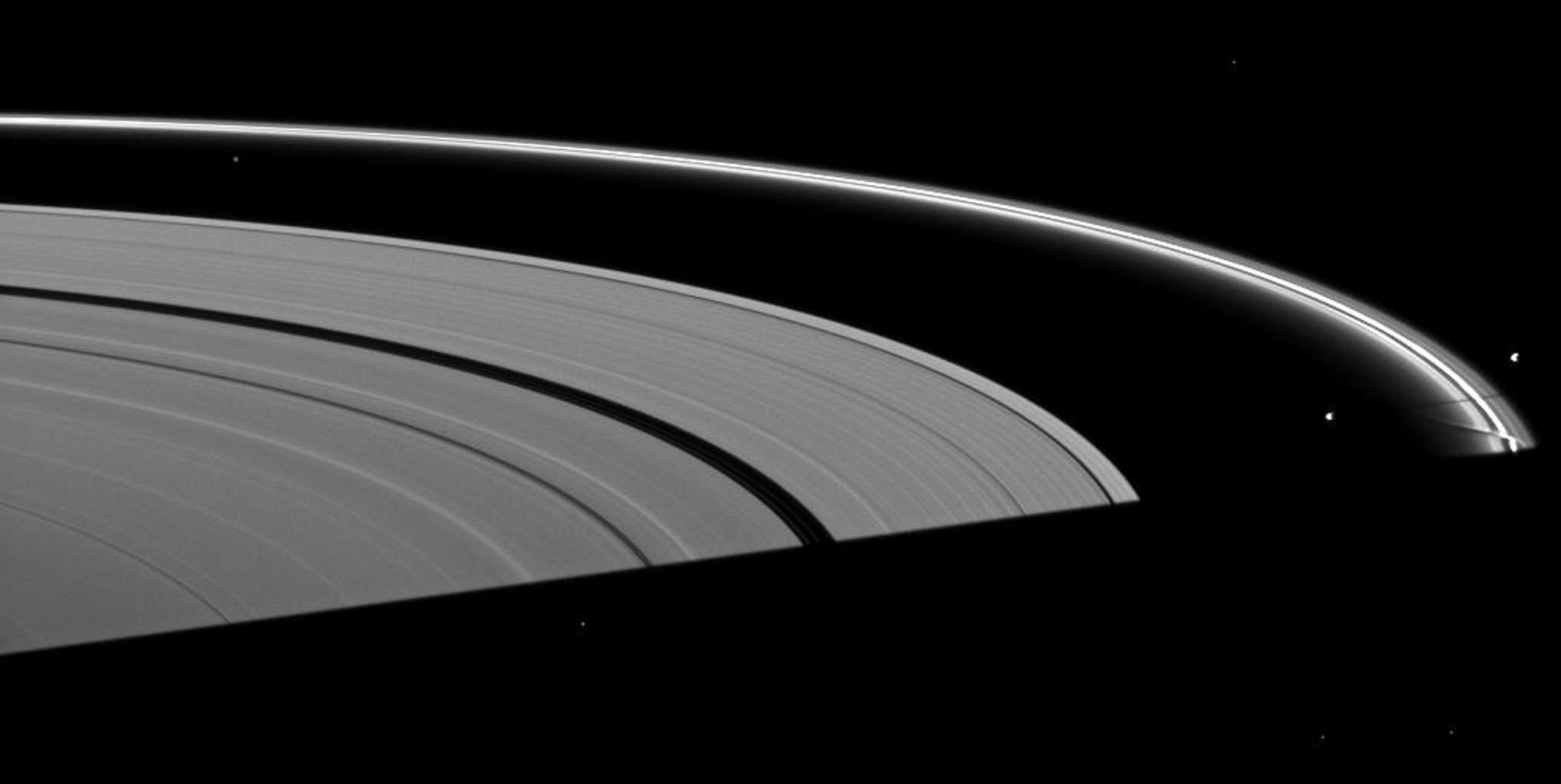 Saturn's moon Prometheus casts a shadow near a streamer-channel created by the moon in the thin F ring in this image taken by NASA's Cassini spacecraft about a month after the planet's August 2009 equinox.
