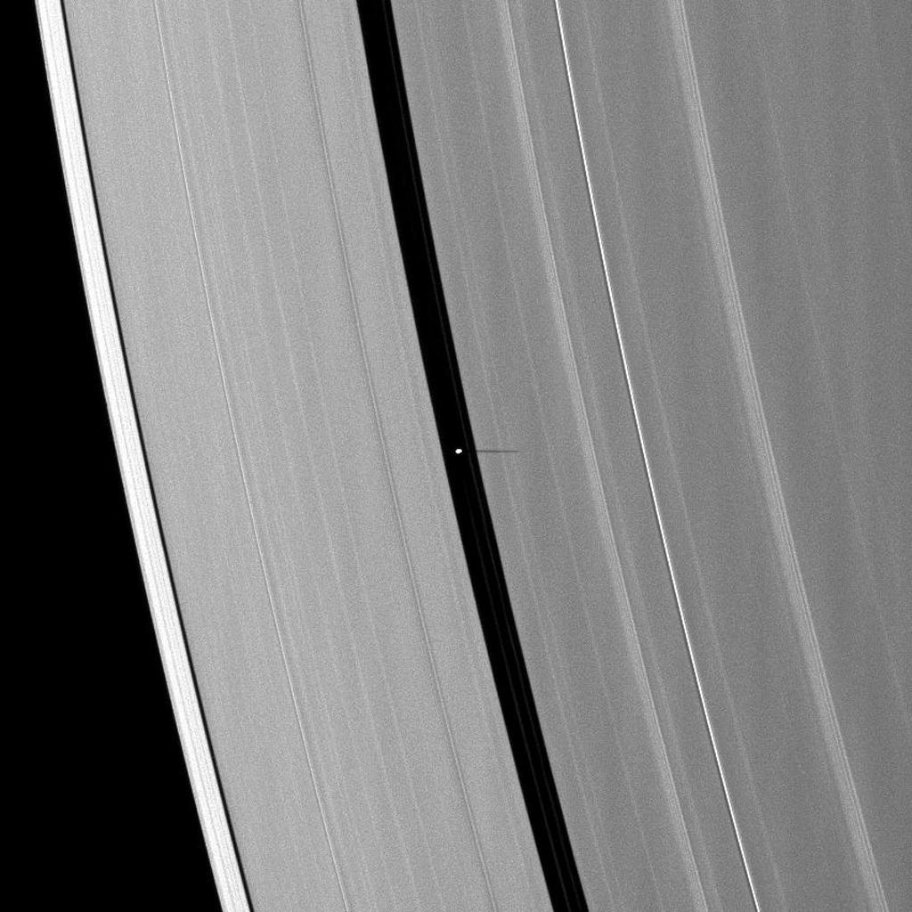 The small moon Pan casts a short shadow on Saturn's A ring in this image taken by NASA's Cassini spacecraft as the planet approached its August 2009 equinox.