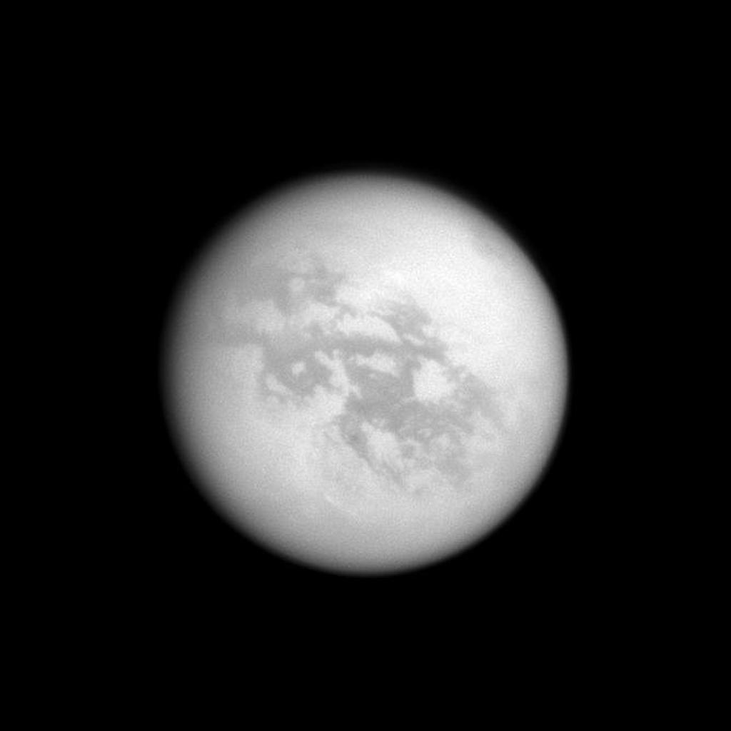 In the top right of NASA's Cassini image, the southern end of Titan's huge lake of liquid hydrocarbons called Kraken Mare is visible near the moon's north pole.