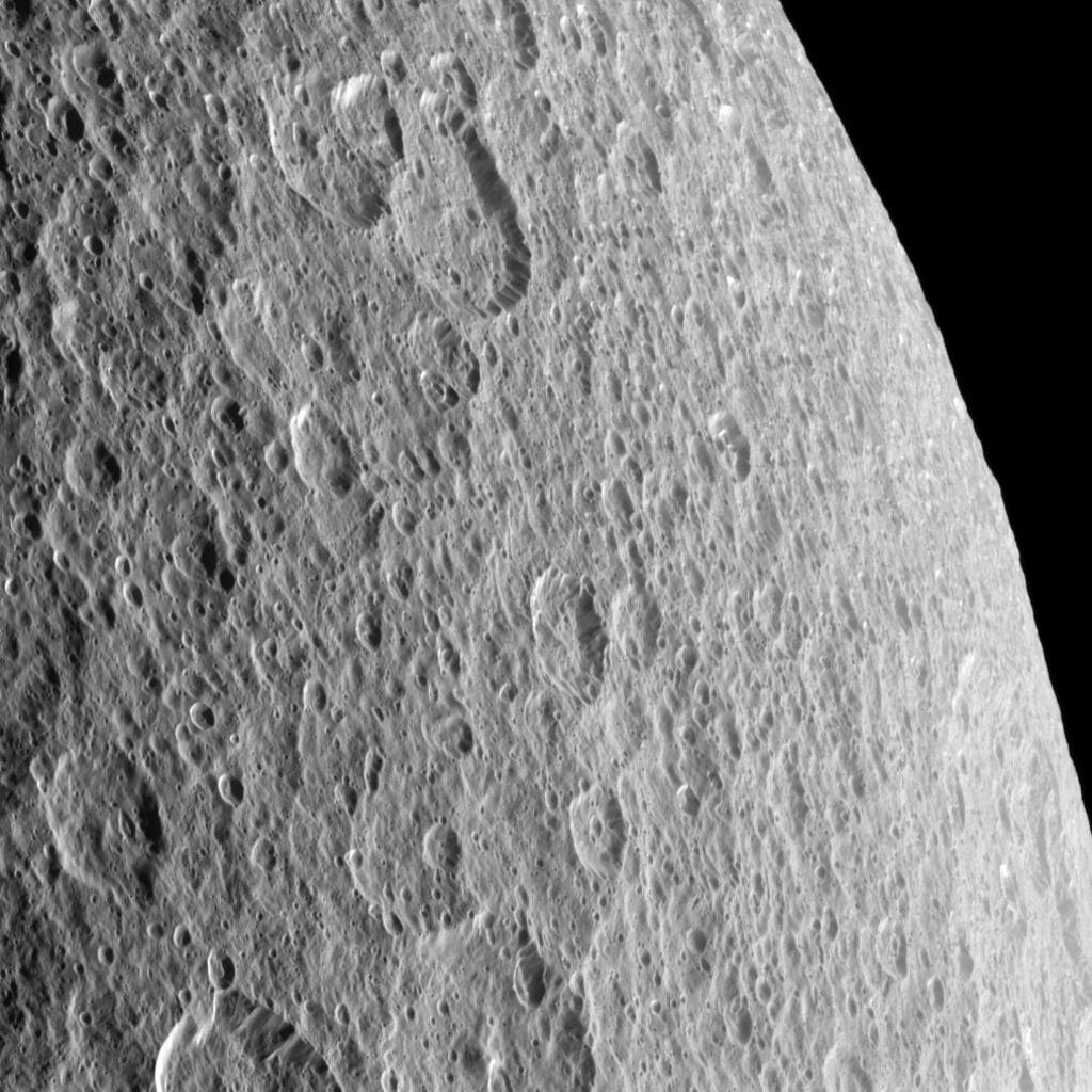 Craters imprinted upon other craters record the long history of impacts endured by Saturn's moon Rhea; this image was taken by NASA's Cassini spacecraft.