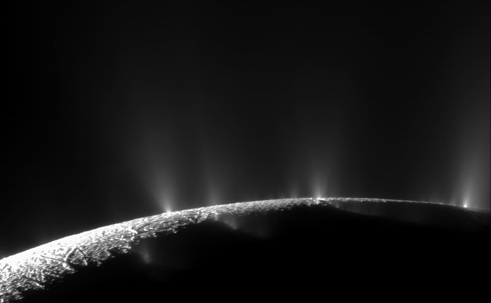 The plumes of Enceladus, captured spewing from the moon's surface by the Cassini spacecraft at a distance of 14,000 kilometers (9,000 miles) in 2010. (Credit: NASA/JPL/Space Science Institute)