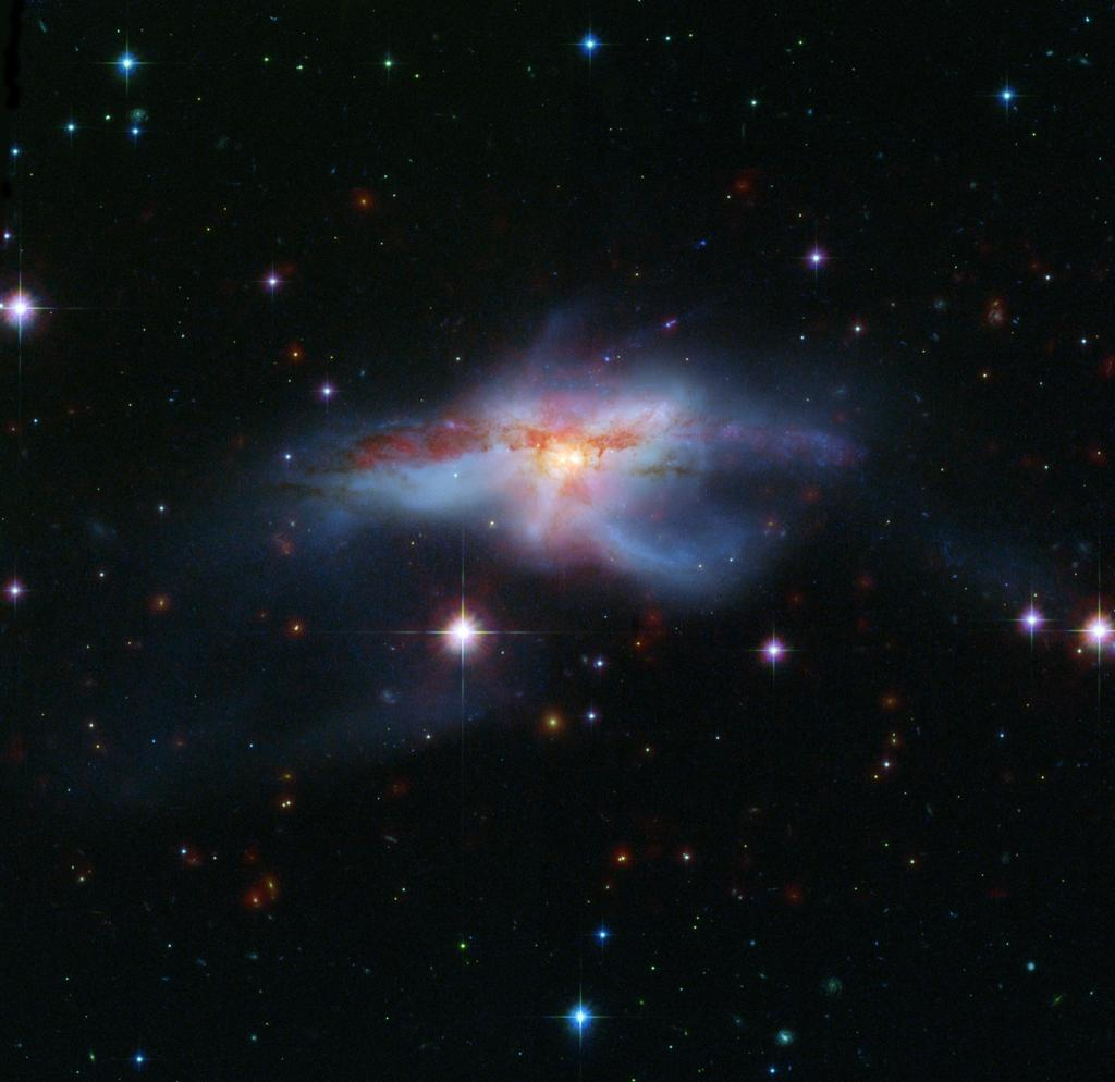 Colliding Galaxies Download Galaxies Collide to Create Hot
