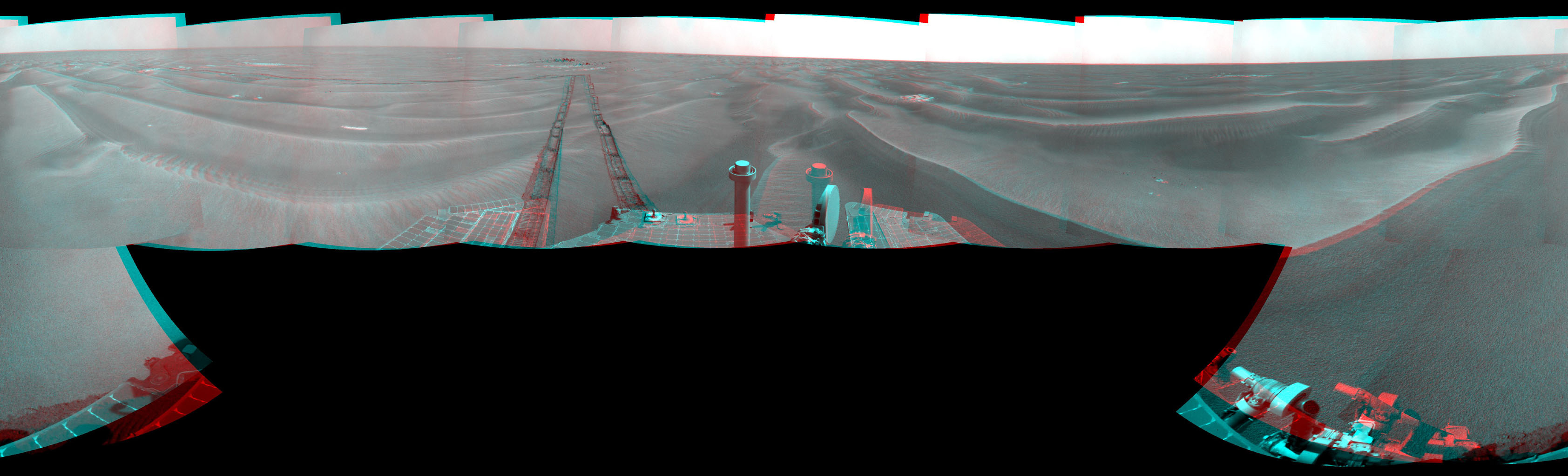 NASA's Mars Exploration Rover Opportunity used its navigation camera to take the images combined into this stereo 180-degree view on March 7-9, 2009. 3D glasses are necessary to view this image.