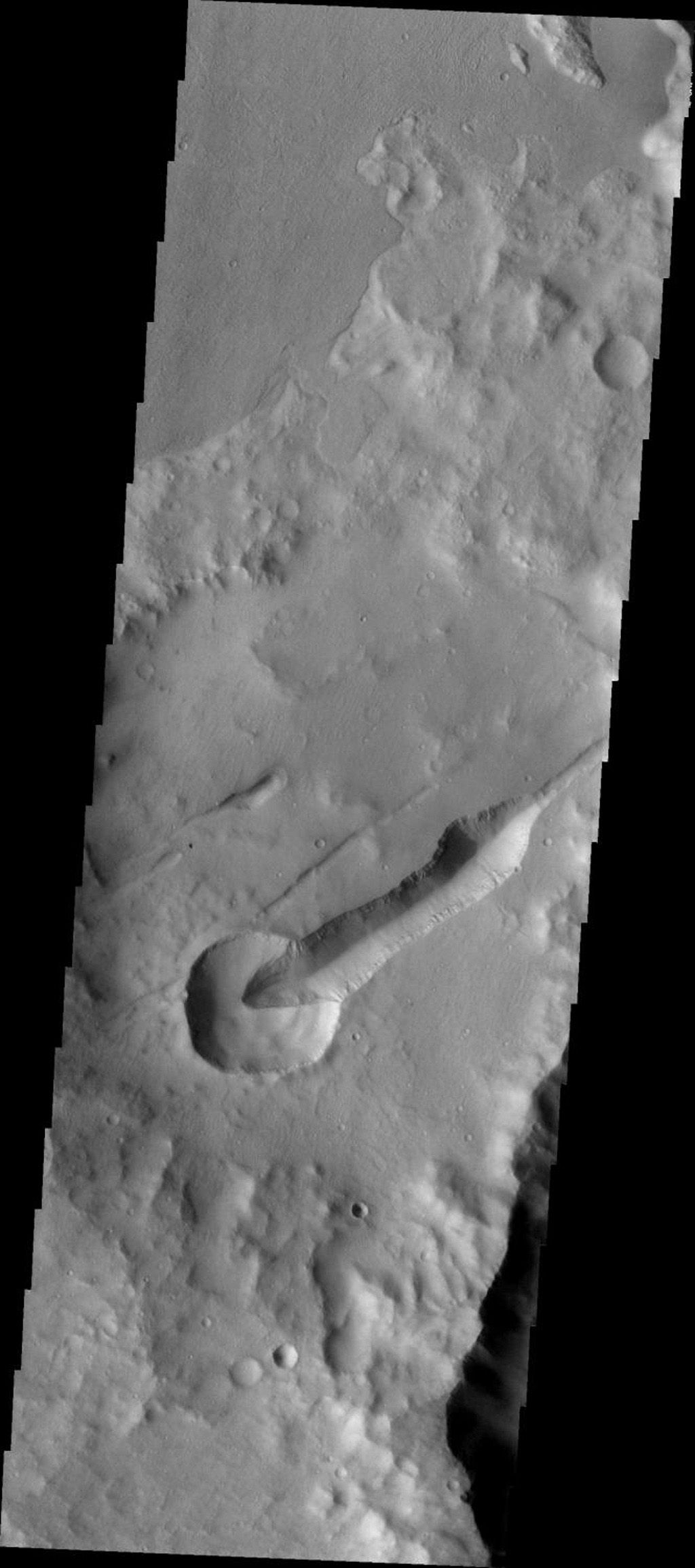 This image from NASA's Mars Odyssey shows part of the Sirenum Fossae on Mars. A smaller crater is cut by a large fracture of the fossae system while the ejecta of the crater covers a small fracture just northwest of the crater.