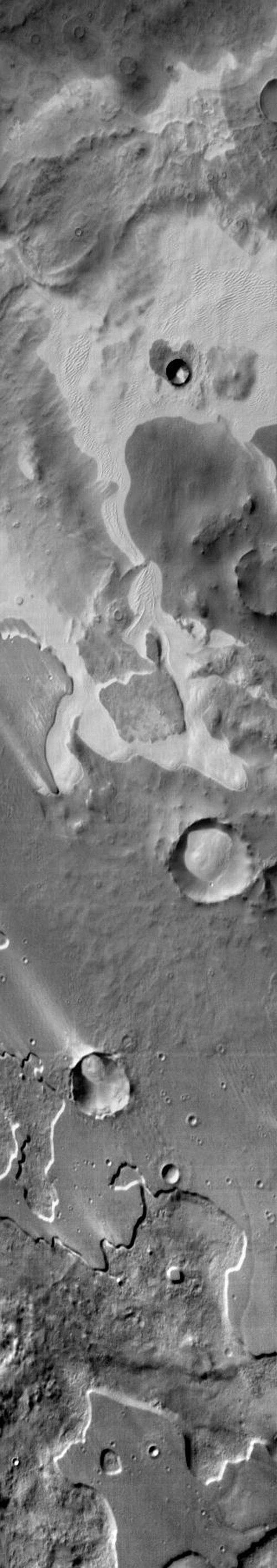 An extensive sand sheet and dunes are located within Pityusa Patera on Mars. This daytime infrared image shows that the sand is relatively warmer than the surrounding materials as seen by NASA's Mars Odyssey spacecraft.