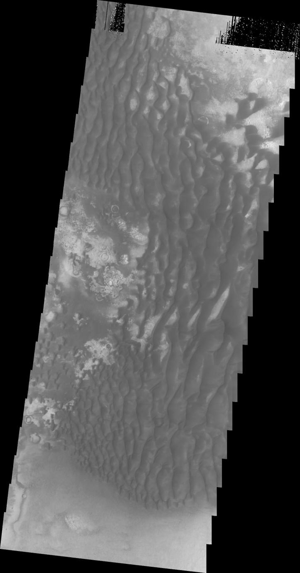 Dark dunes on Mars are seen in this image as seen by NASA's Mars Odyssey spacecraft.