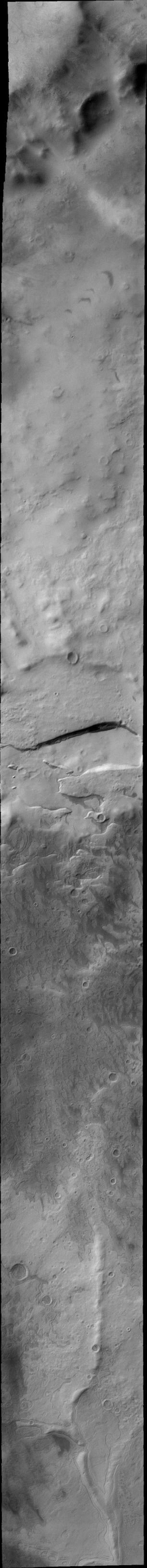 This 2001 Mars Odyssey image shows Promethei Planum, located near Mars' south polar cap, containing many different surface textures.