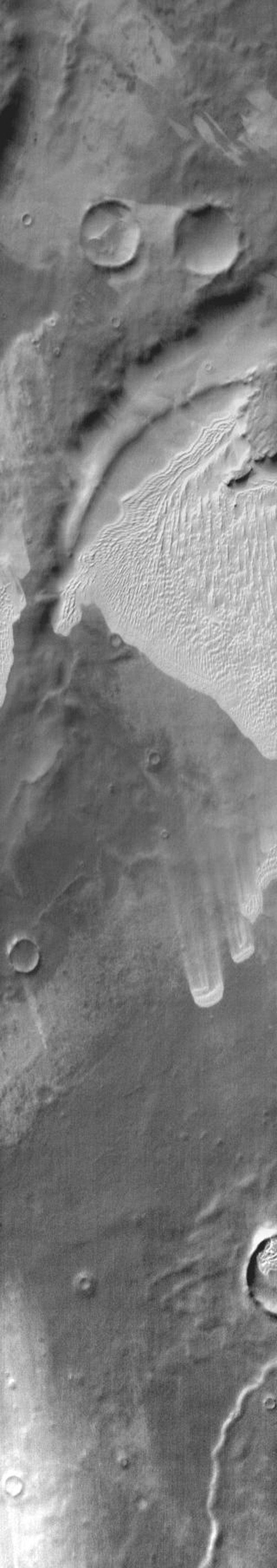 This 2001 Mars Odyssey image shows an extensive sand sheet near Mar's south polar cap.