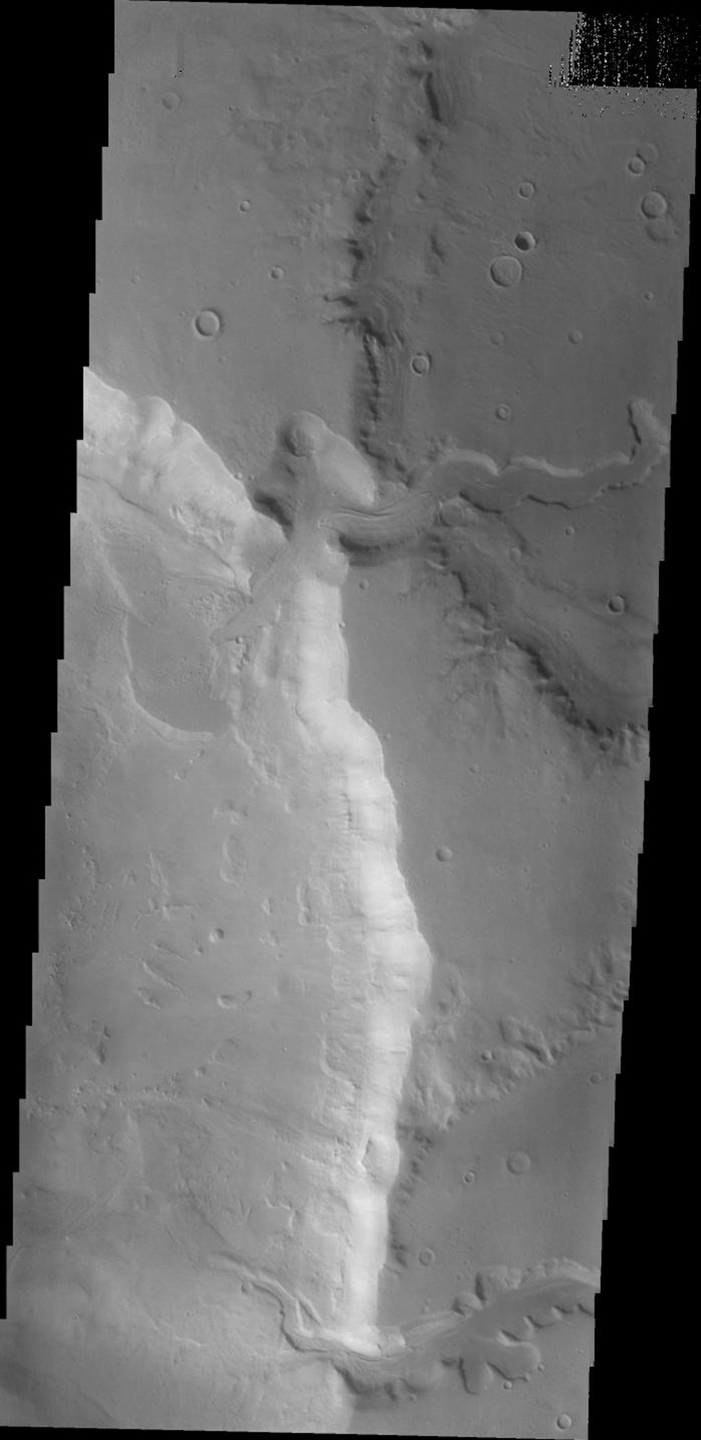 This 2001 Mars Odyssey image shows two channels entering an unnamed crater in Arabia Terra on Mars. The northern channel has formed a delta deposit on the floor of the crater.