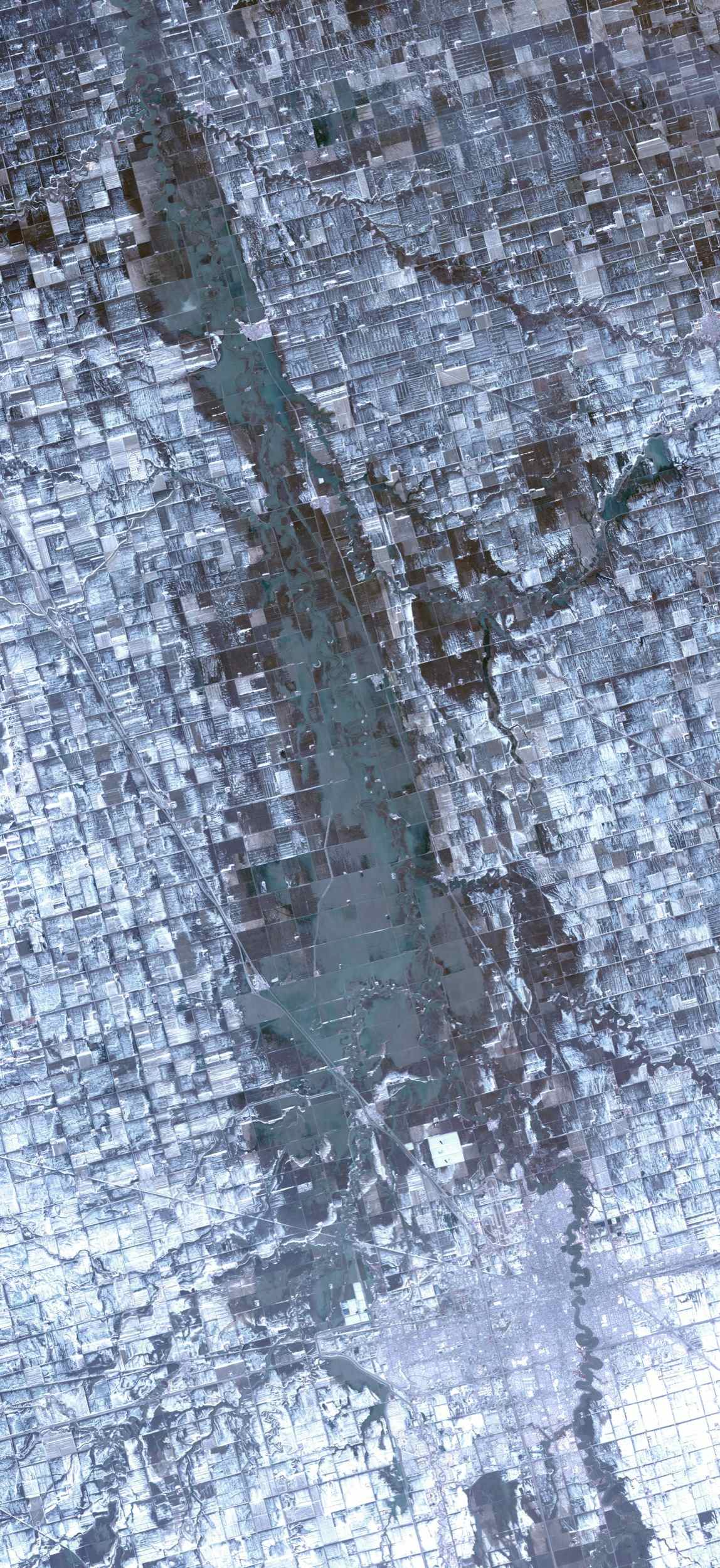 The Spring, 2009 floods along the Red River between North Dakota and Minnesota affected cities in the two states, especially Fargo and Whitehead. NASA's Terra spacecraft acquired this image on April 9, 2009.