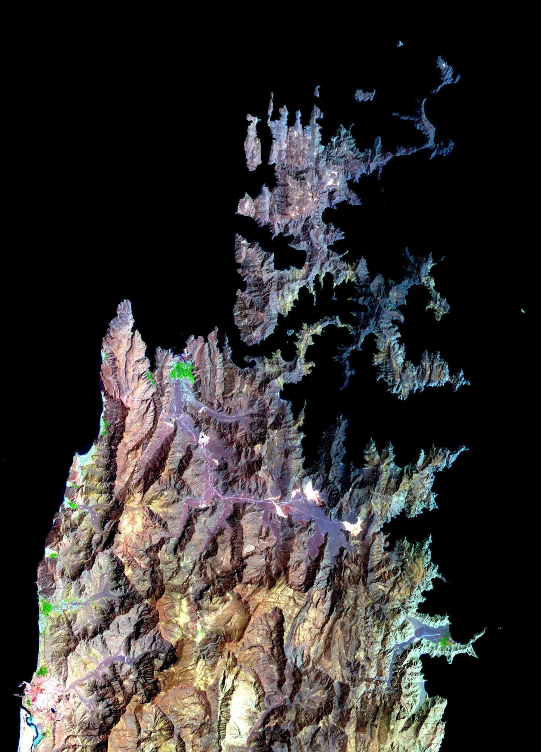 The Musandam Peninsula is part of Oman, separated from the rest of the country by the United Arab Emirates. This image was acquired by NASA's Terra satellite on March 27, 2004.