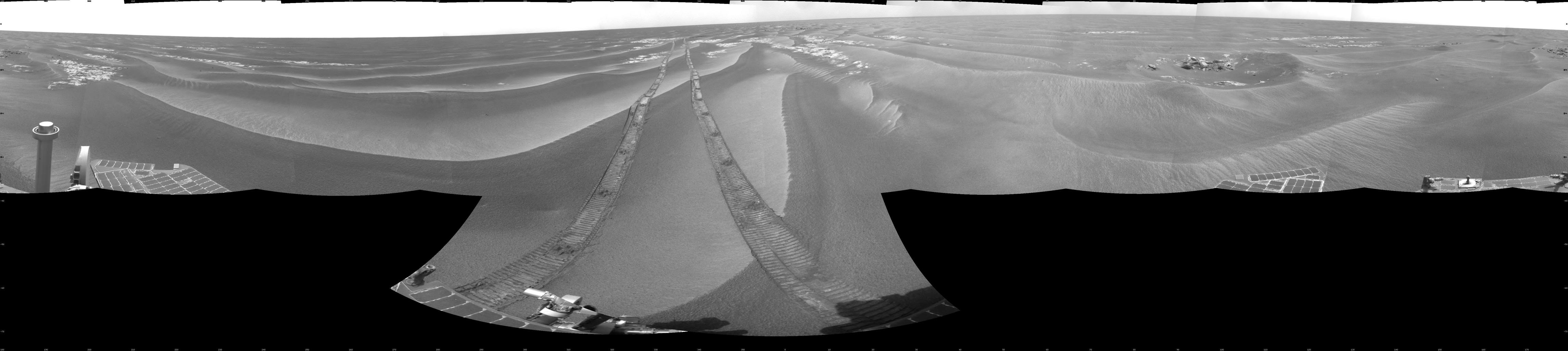 NASA's Opportunity had driven 62.5 meters (205 feet) that sol, southward away from an outcrop called 'Penrhyn,' which the rover had been examining for a few sols, and toward a crater called 'Adventure.' This is a cylindrical projection.