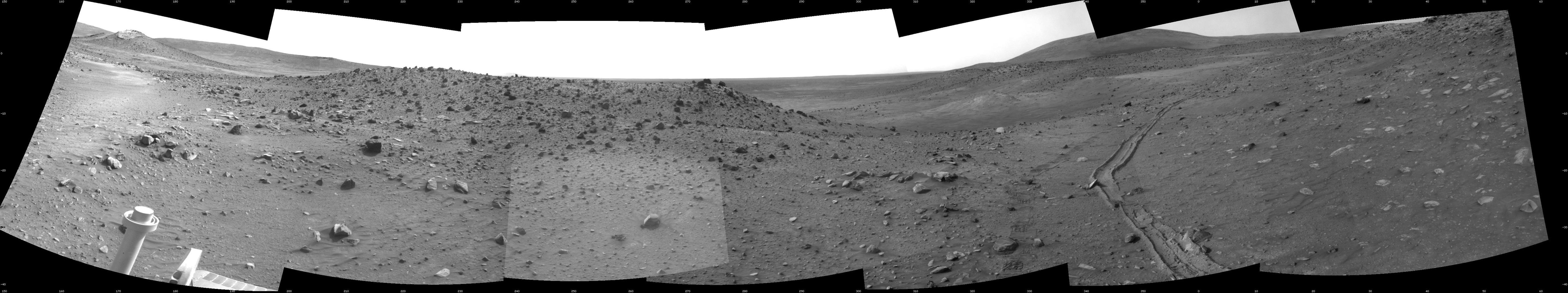 This scene combines seven frames taken by the navigation camera on NASA's Mars Exploration Rover Spirit during the 1,891st Martian day, or sol, of Spirit's mission on Mars (April 28, 2009).