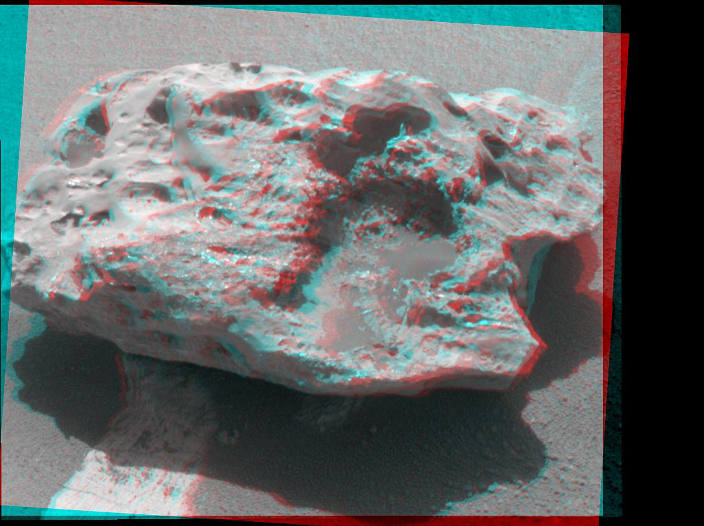 Composition measurements by NASA's Mars Exploration Rover Opportunity confirm that this rock on the Martian surface is an iron-nickel meteorite. 3D glasses are necessary to view this image.
