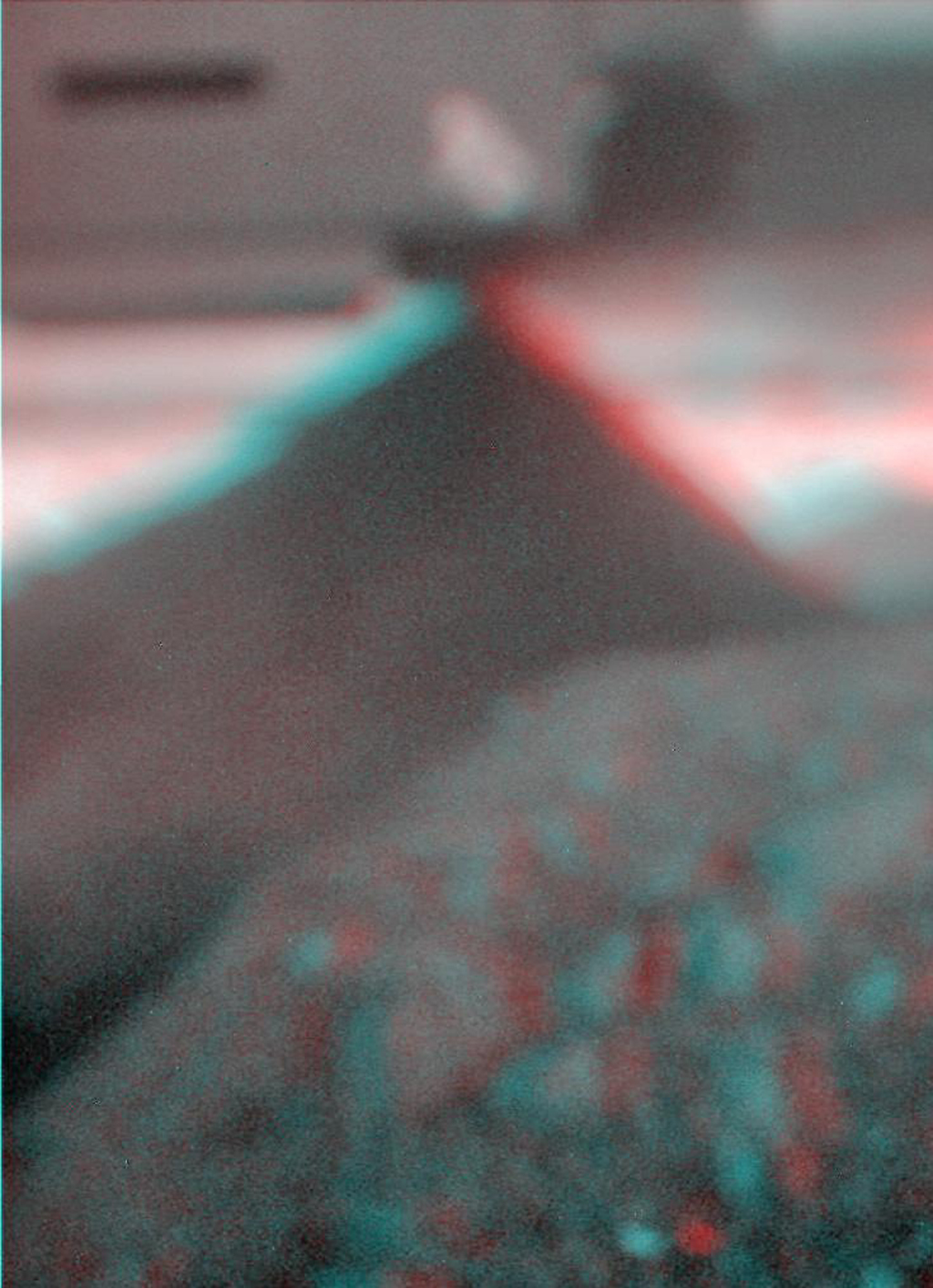 This stereo view combines a pair of images taken by the microscopic imager on NASA's Mars Exploration Rover Spirit during the 1,925th Martian day (sol) of Spirit's mission on Mars (June 2, 2009). 3D glasses are necessary to view this image.