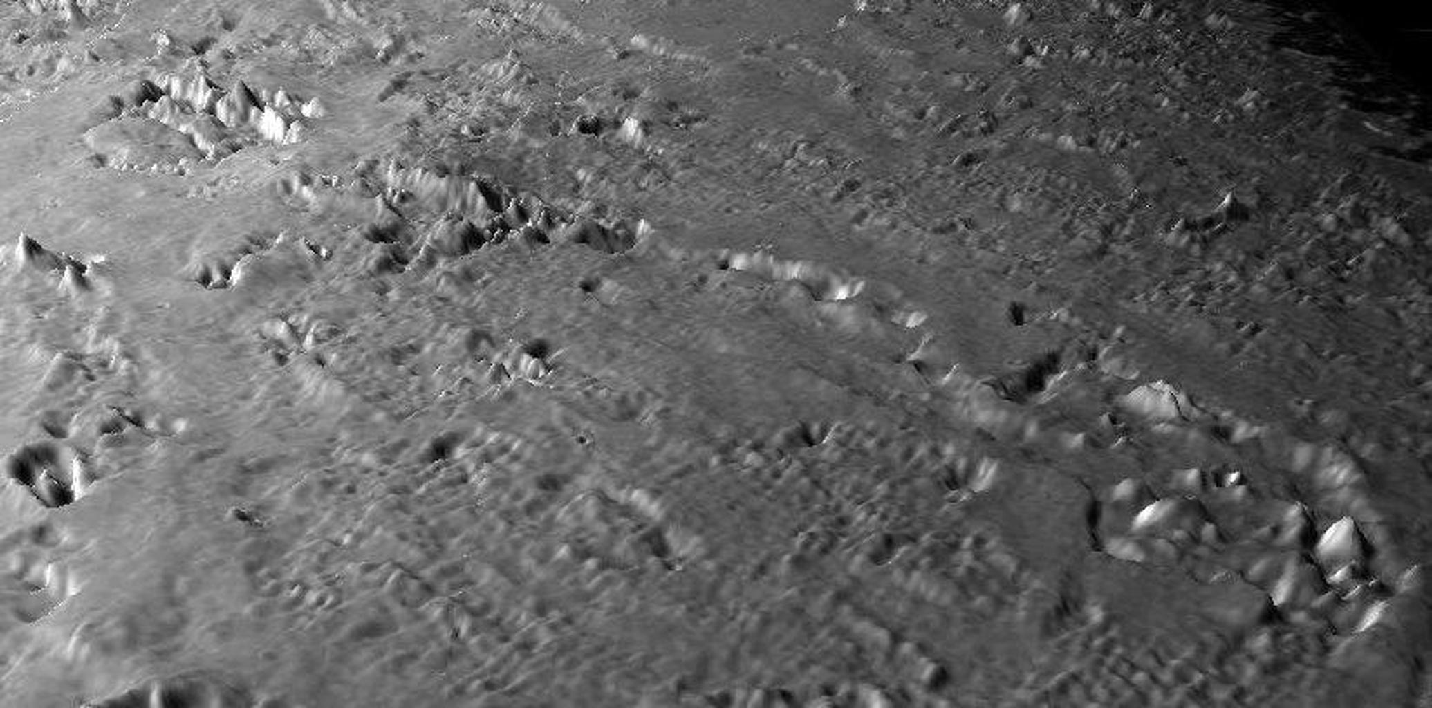 This view of the volcanic plains of Neptune's moon Triton was produced using topographic maps derived from images acquired by NASA's Voyager spacecraft during its August 1989 flyby, 20 years ago this week.