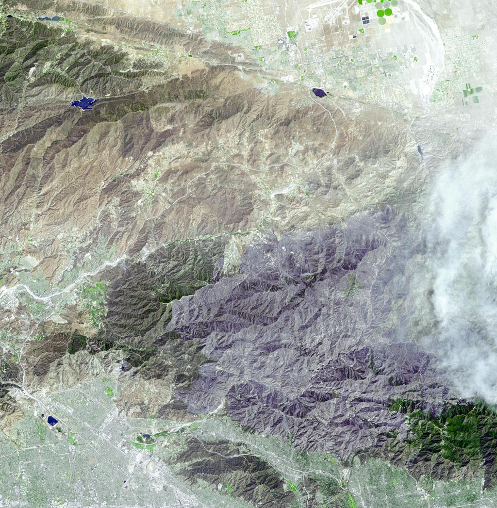 JPL's Advanced Spaceborne Thermal Emission and Reflection Radiometer aboard NASA's Terra satellite captured this simulated natural color image of the Station fire, burning in the San Gabriel Mountains.