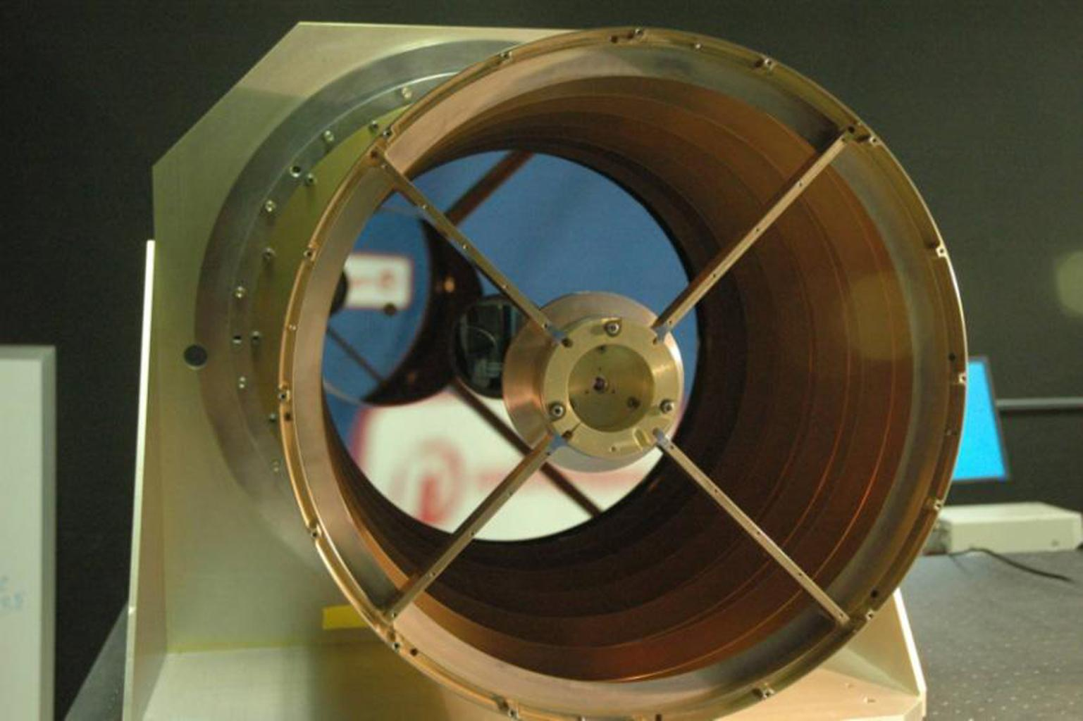 View looking down the barrel of NASA's Wide-field Infrared Survey Explorer telescope. This image shows the 40 cm WISE primary mirror, which is the largest optical element in the WISE system.