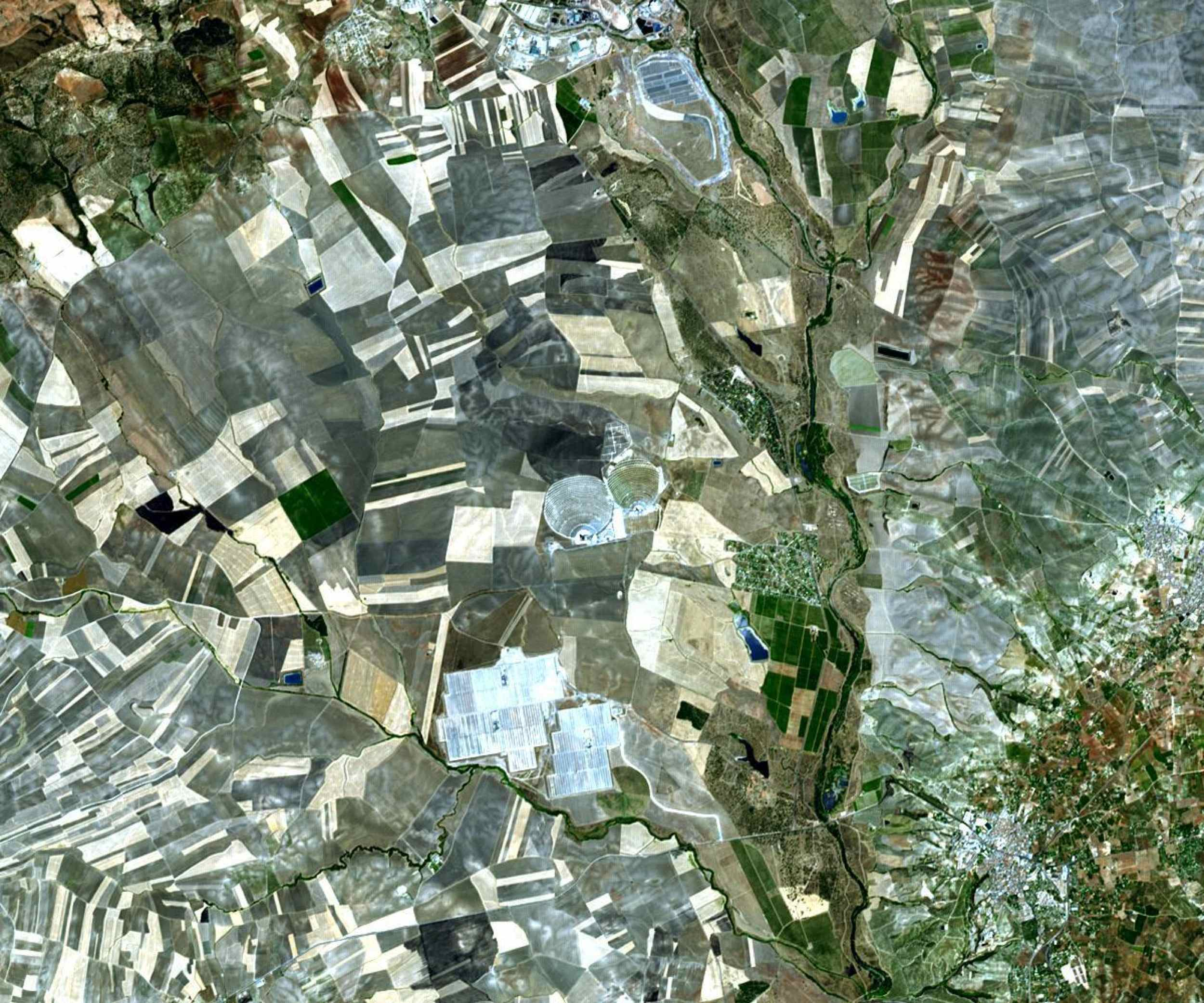 The world's largest solar power tower recently began operating outside Seville, Spain -- and it marks a historic moment in the saga of renewable energy. This image was acquired by NASA's Terra spacecraft.