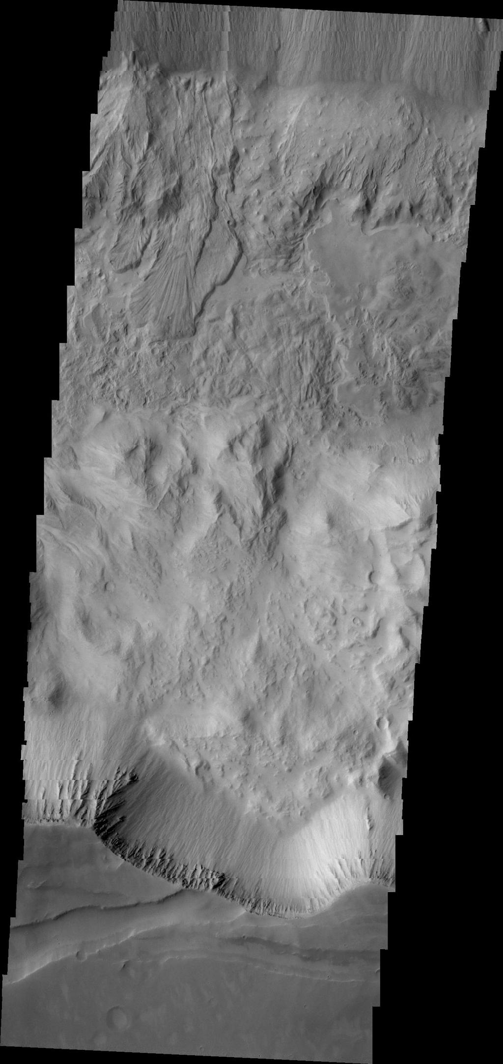 Two landslide deposits are visible in this image of Tithonium Chasma taken by NASA's 2001 Mars Odyssey spacecraft.