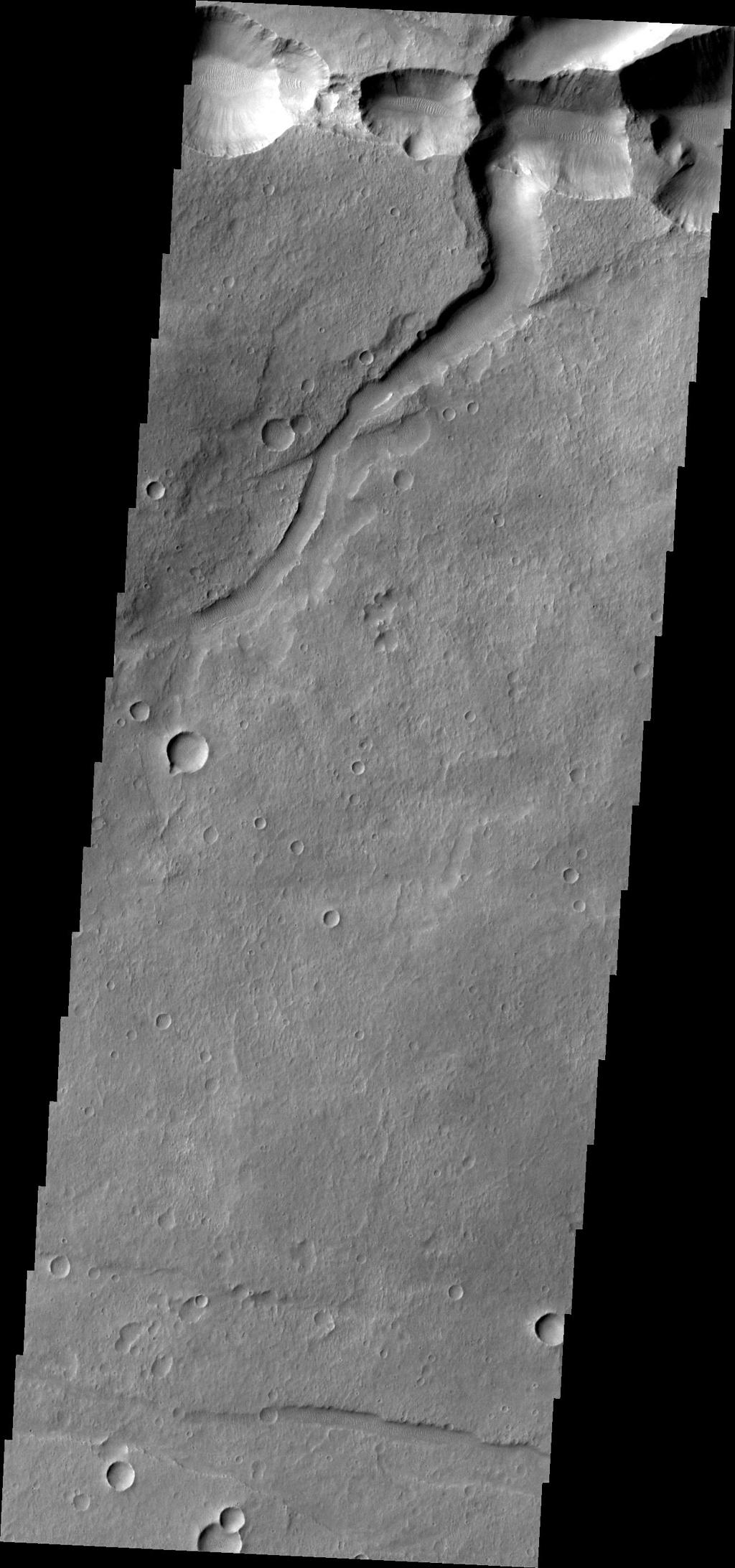 The interconnected collapse pits at the top of this image, taken by NASA's 2001 Mars Odyssey spacecraft, are part of Coprates Catena. Notice the dunes in the bottom of each pit.