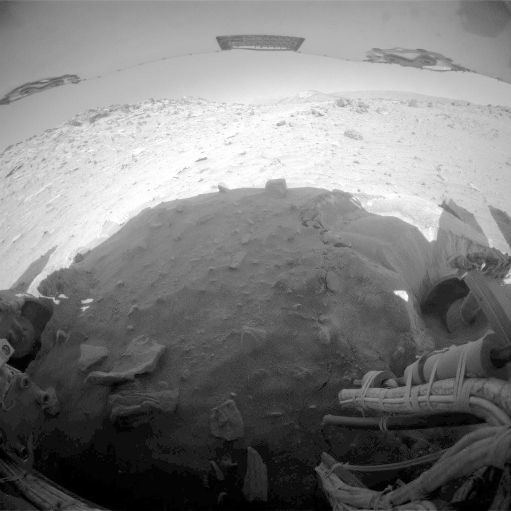This image is one of two frames showing NASA's Spirit driving backward as next technique for attempting to extricate the rover from the sand trap where it is embedded. Go to the Photojournal for the animation.