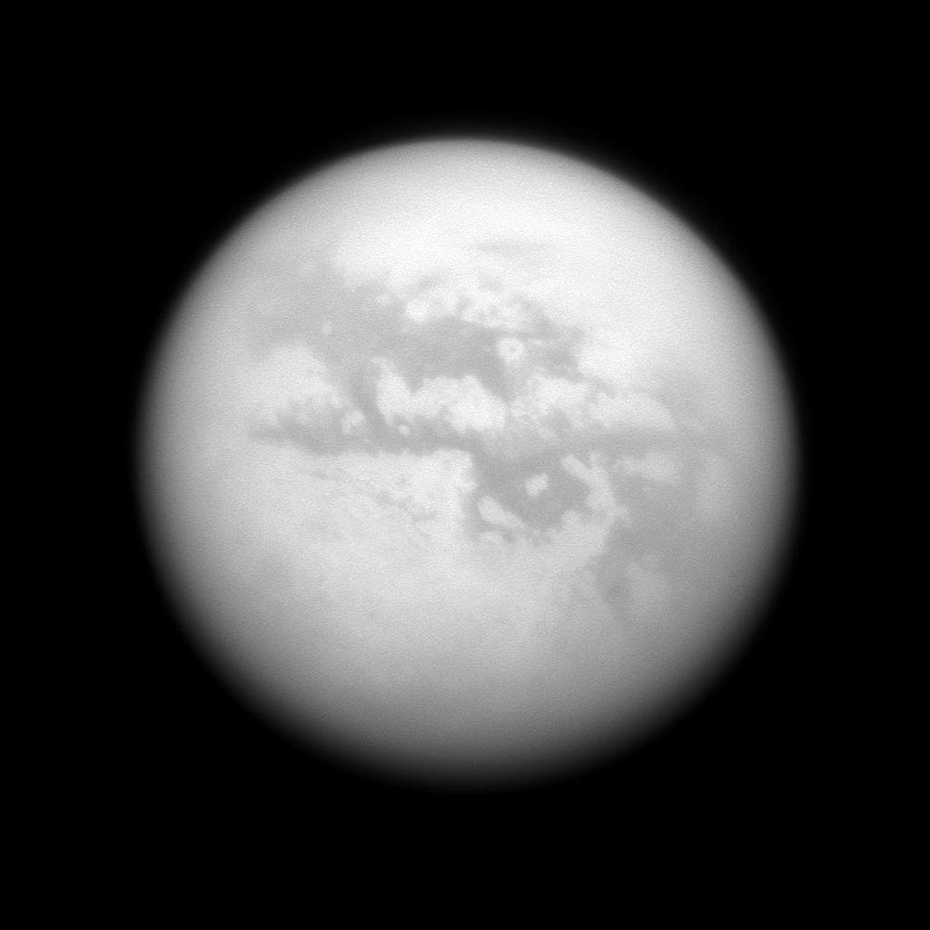 NASA's Cassini spacecraft gazes at several albedo features on Saturn's largest moon, Titan. Left to right are four dark regions: Fensal, Aztlan, Aaru and a part of Senkyo.