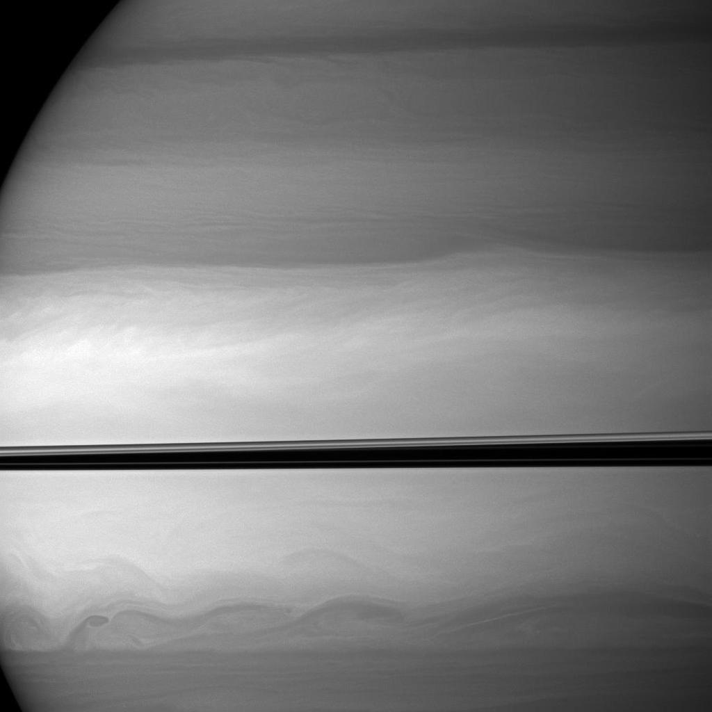 NASA's Cassini spacecraft watches as clouds swirl through Saturn's equatorial latitudes.