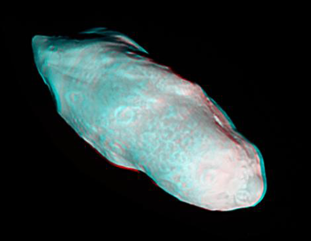 Saturn's potato-shaped moon Prometheus is rendered in three dimensions in this close-up from NASA's Cassini spacecraft. You will need 3-D glasses to view this image.