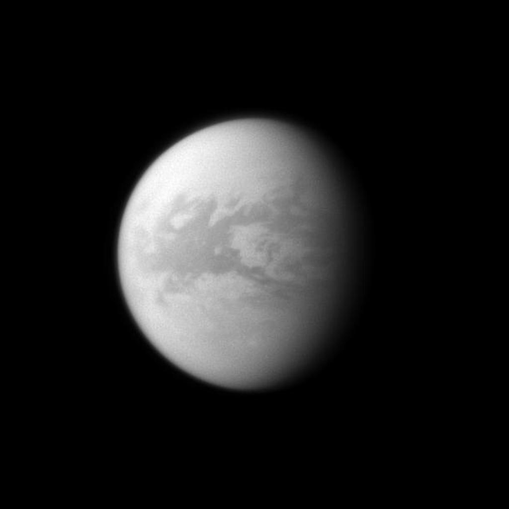 NASA's Cassini spacecraft looks toward the dark region of Belet on Saturn's largest moon, Titan. This large region on the moon has a low albedo, meaning it diffusely reflects little light.