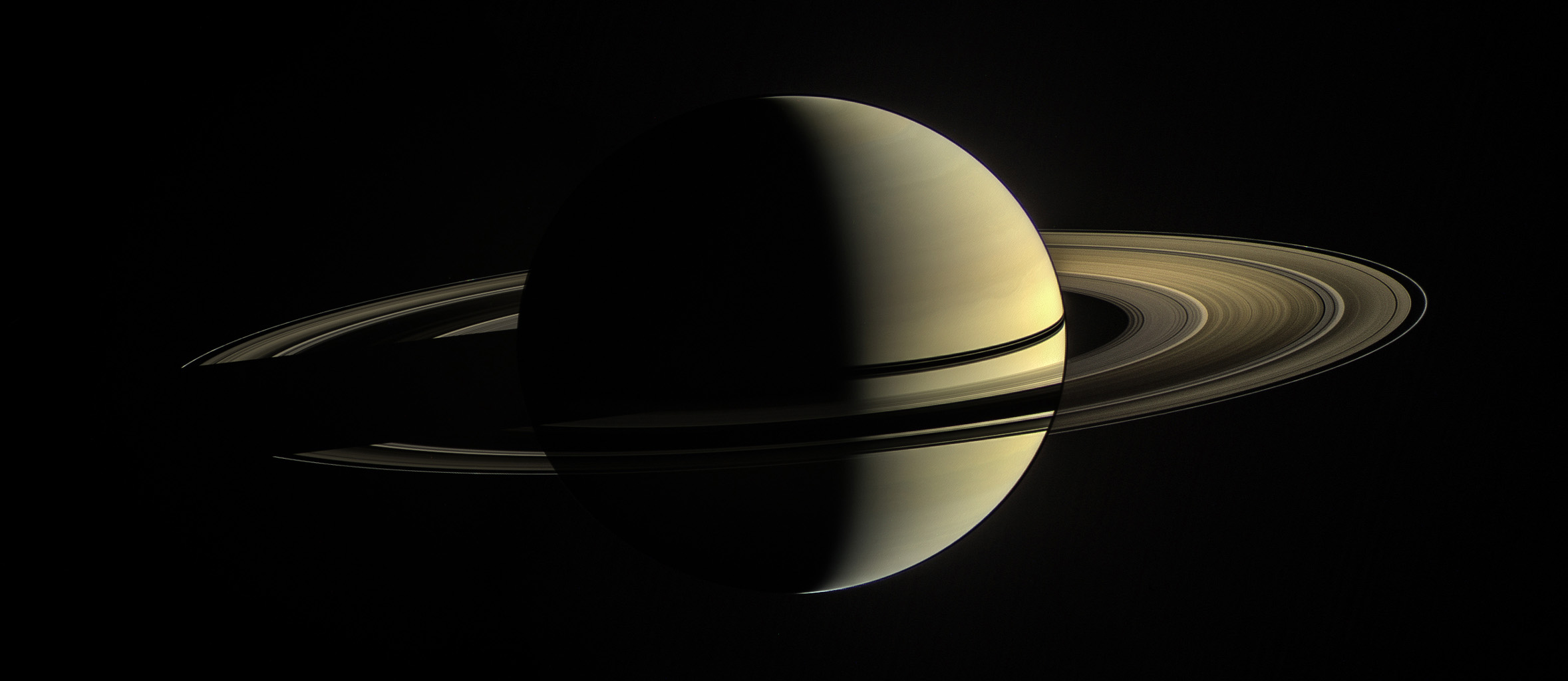 This image from NASA's Cassini spacecraft shows its view from orbit around Saturn on Jan. 2, 2010. The rings on the night side of the planet have been brightened significantly to more clearly reveal their features.