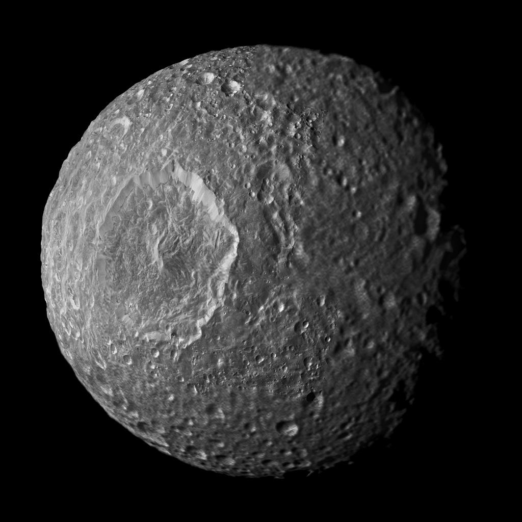 Relatively dark regions below bright crater walls and streaks on some of the walls are seen in this mosaic of Saturn's moon Mimas, created from images taken by NASA's Cassini spacecraft during its closest flyby of the moon.