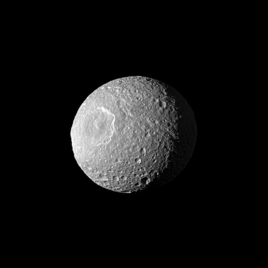 Appearing like a cyclops gazing off into space, Saturn's moon Mimas and its large Herschel Crater are profiled from NASA's Cassini spacecraft. Herschel Crater is 130 kilometers (80 miles) wide and covers most of the left of this image.