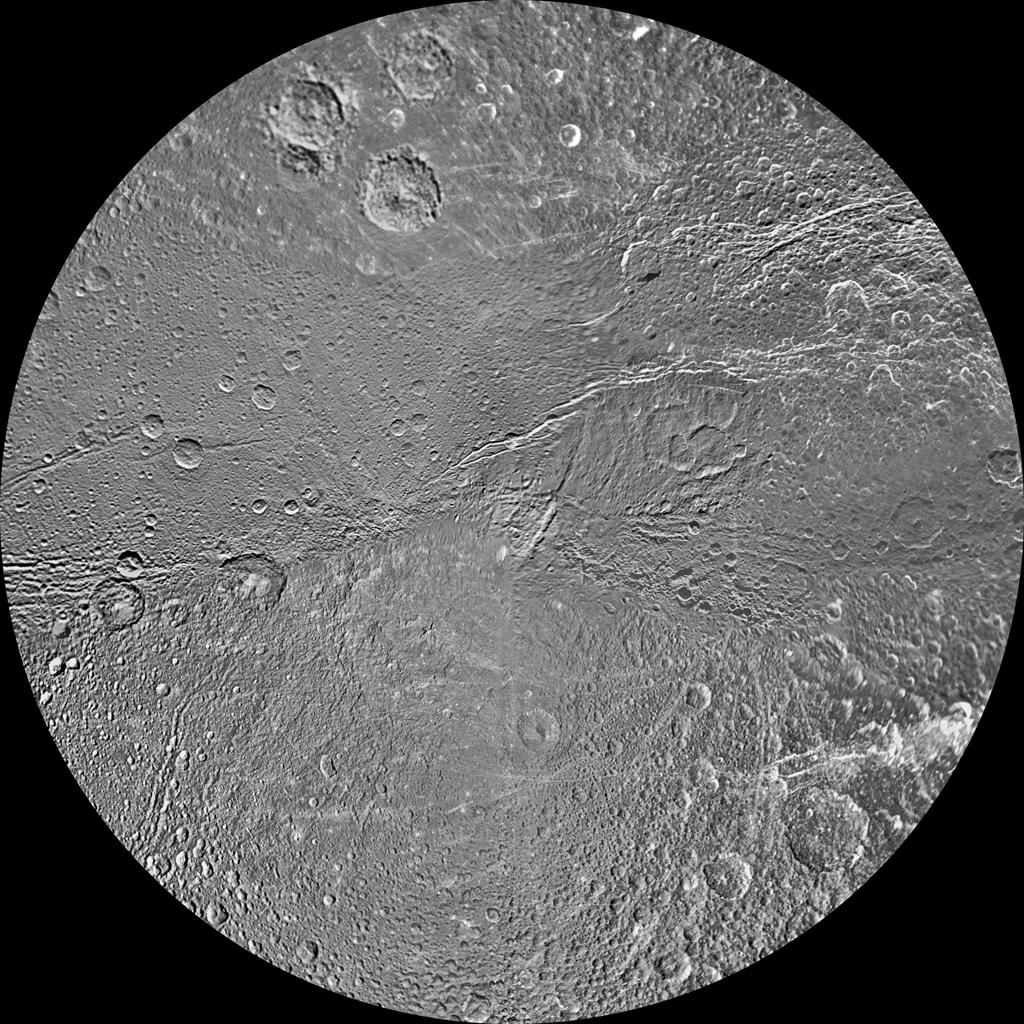 The southern hemisphere of Saturn's moon Dione is seen in this polar stereographic maps, mosaicked from the best-available clear-filter images from NASA's Cassini and Voyager missions.