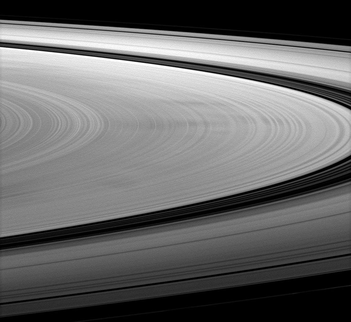 The Cassini spacecraft images dark spokes on Saturn's B ring. Spokes are radial markings on Saturn's rings that continue to interest scientists, and they can be seen here stretching left to right across the image.