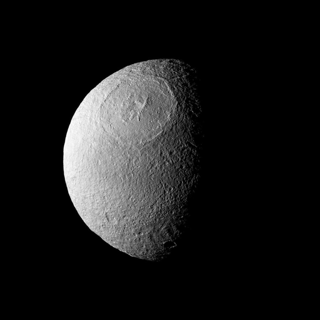 Odysseus Crater, with a size of epic proportions, stretches across a large northern expanse on Saturn's moon Tethys in this image taken by NASA's Cassini spacecraft.