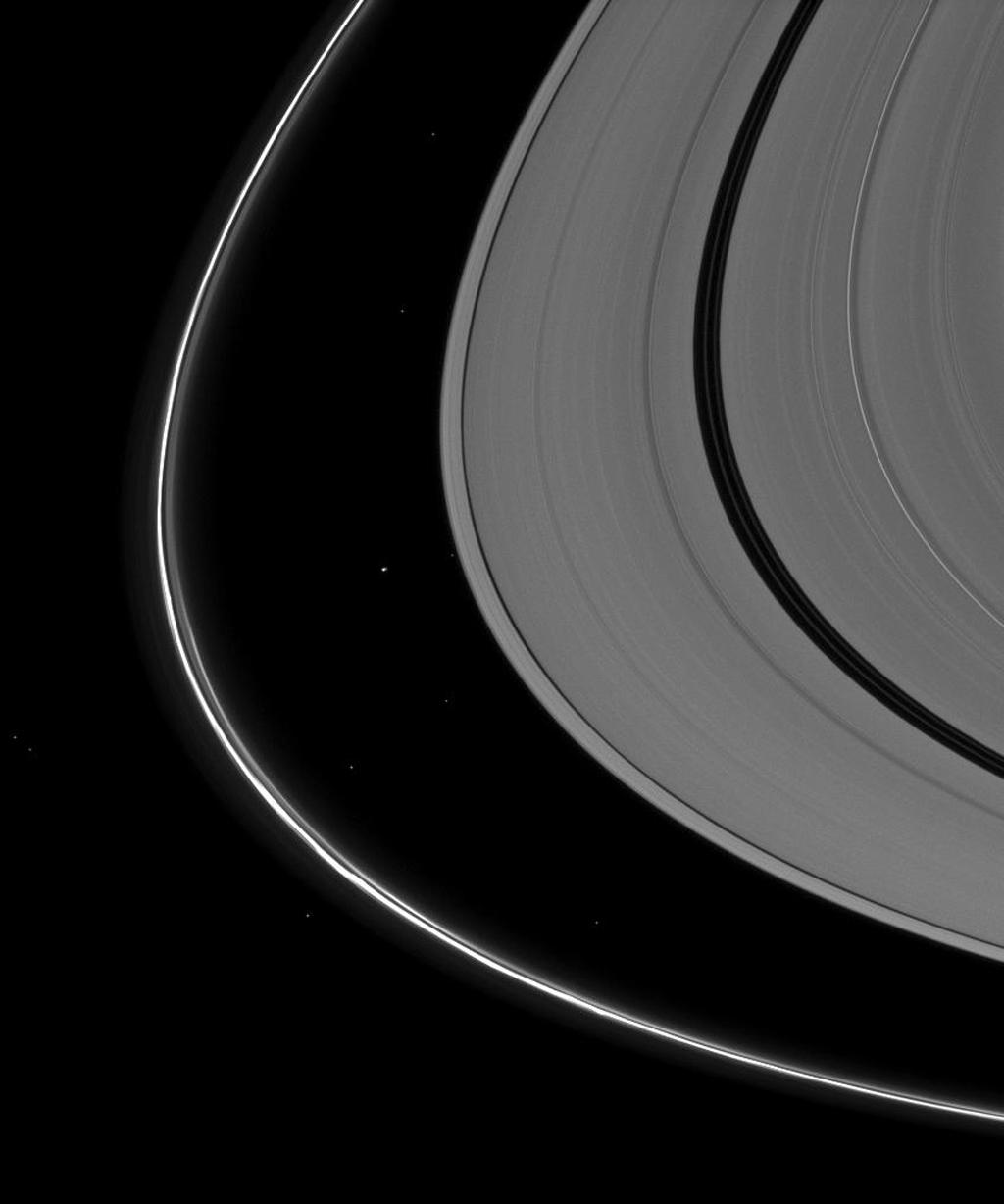 Saturn's tiny moon Atlas, just to the left of the center of the image, appears almost indistinguishable from the background stars seen in this image captured by NASA's Cassini spacecraft.