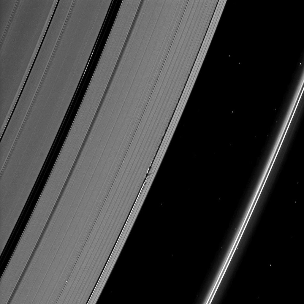 Shadows are cast by Daphnis and the moon's attendant edge waves in this image from NASA's Cassini spacecraft taken about a month and a half before the Saturn's August 2009 equinox.