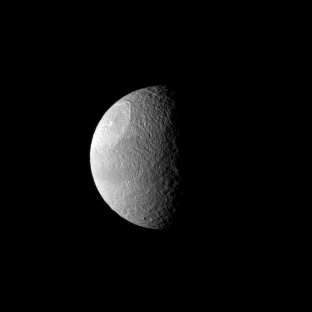 A huge impact created Odysseus Crater, which covers a large part of Saturn's moon Tethys in this image from NASA's Cassini spacecraft.
