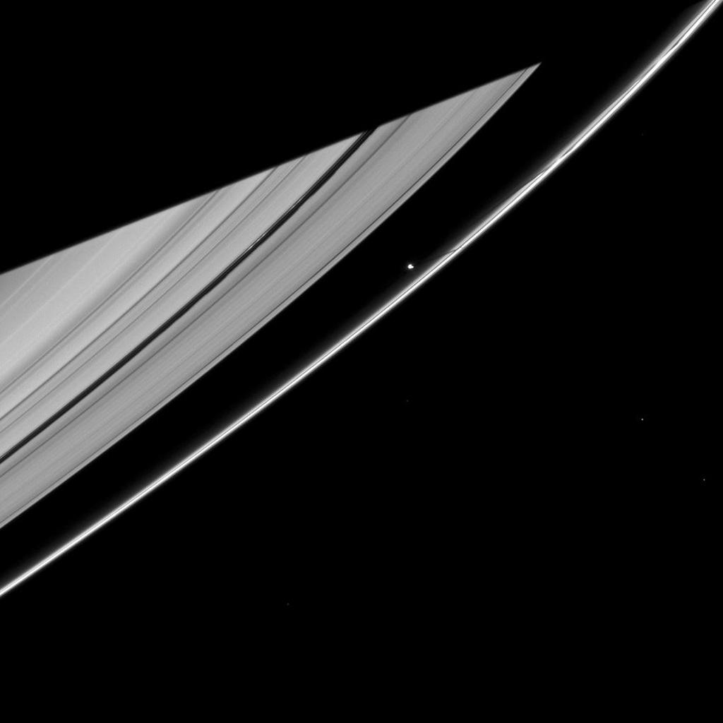 Saturn's moon Prometheus casts a narrow shadow on the rings near the much larger shadow cast by the planet in this image taken by NASA's Cassini spacecraft about five months after Saturn's August 2009 equinox.