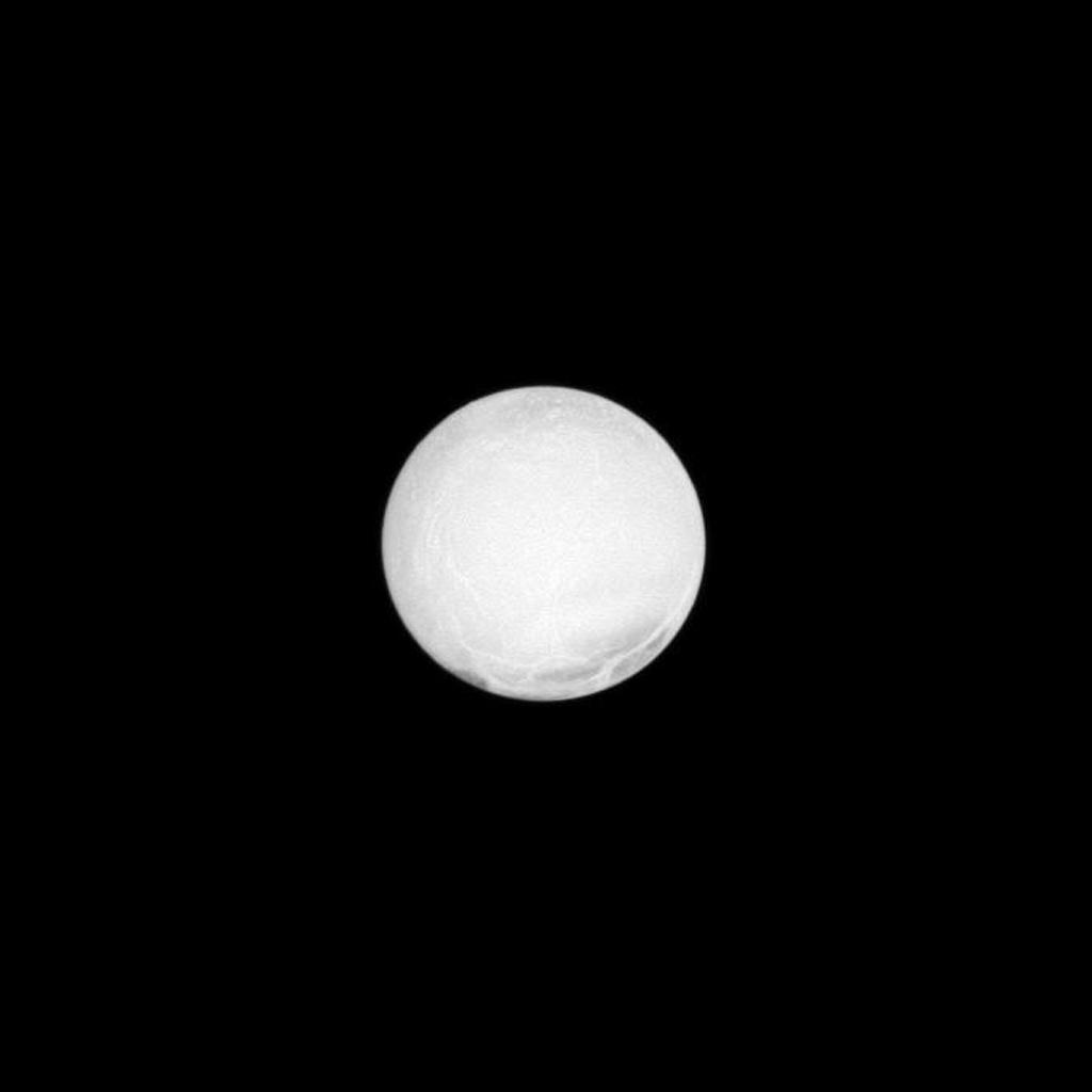 The highly reflective surface of Saturn's moon Enceladus is almost completely illuminated in this NASA Cassini spacecraft image taken at a low phase angle.