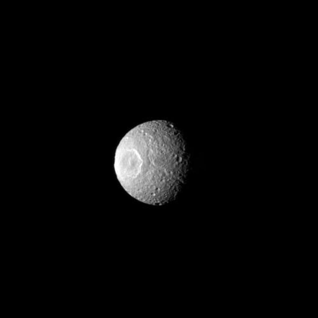 Herschel Crater features prominently on the moon Mimas in this NASA Cassini spacecraft image, which gives the impression of an eye staring out into space.